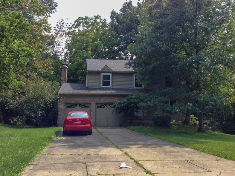 Property to Renovate Before of two story house in woods