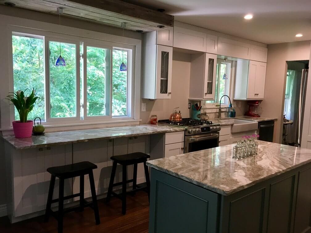 kitchen renovation with white cabinets and bamboo floors