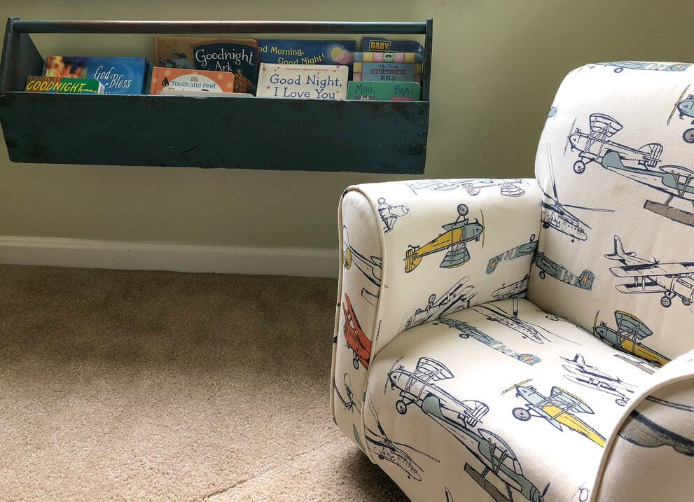 Montessori toddler bedroom reading nook with low shelves