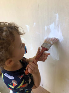 child painting toy box white