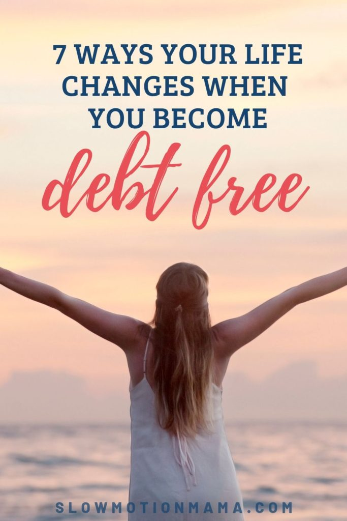 woman celebrating debt freedom with hands in air