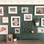 turquoise grasscloth gallery wall with white frames